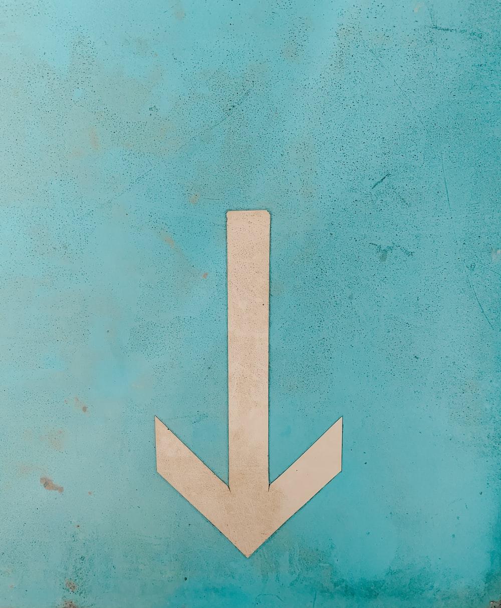 beige arrow