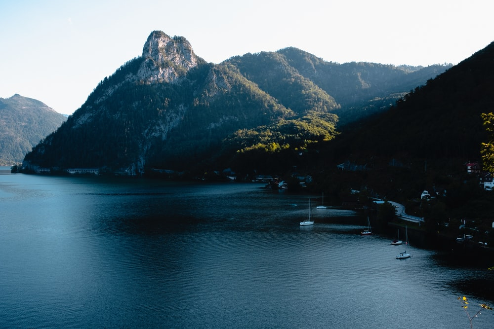 calm sea beside mountain range