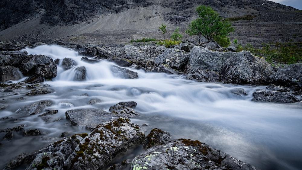 river beside mountain