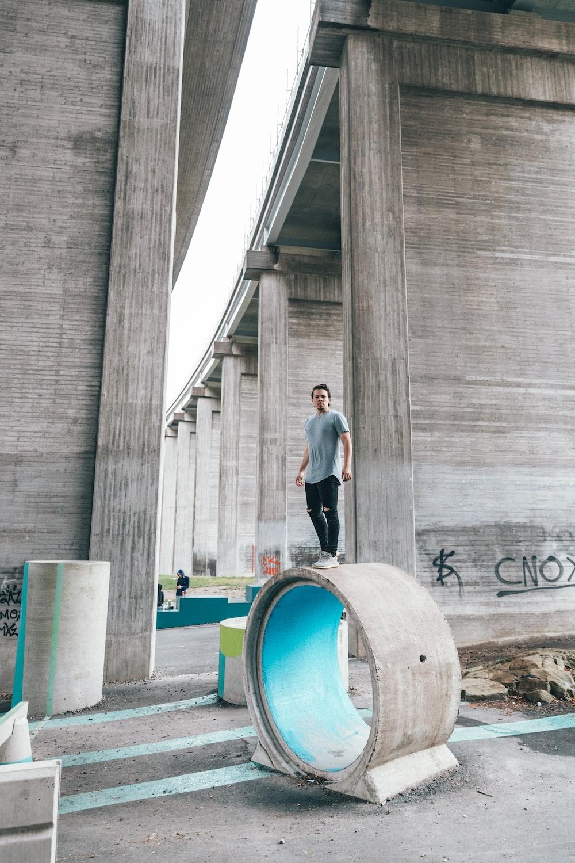 man standing near structure