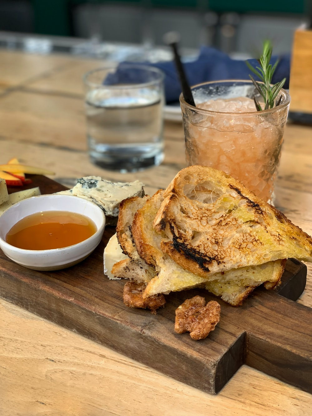 egg omelet on top sandwich beside cocktail drink