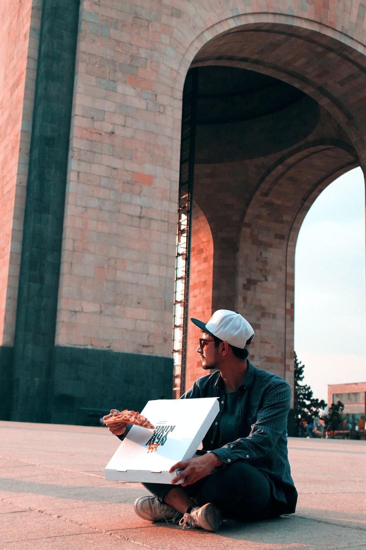 man sitting near structure