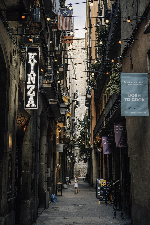 girl stands between alley
