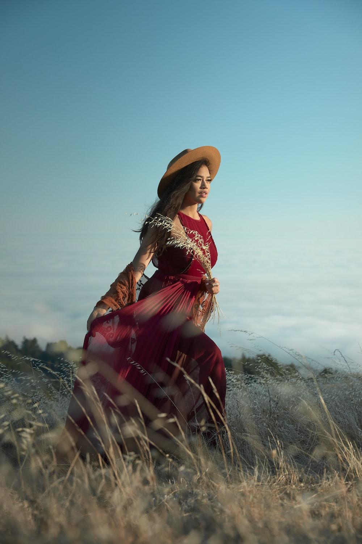woman wears red long-sleeved dress