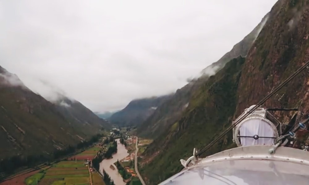 view of valley under white skies
