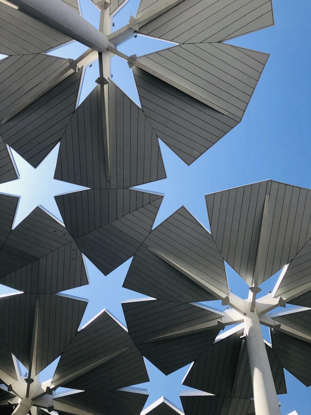 gray metal roof under blue skies