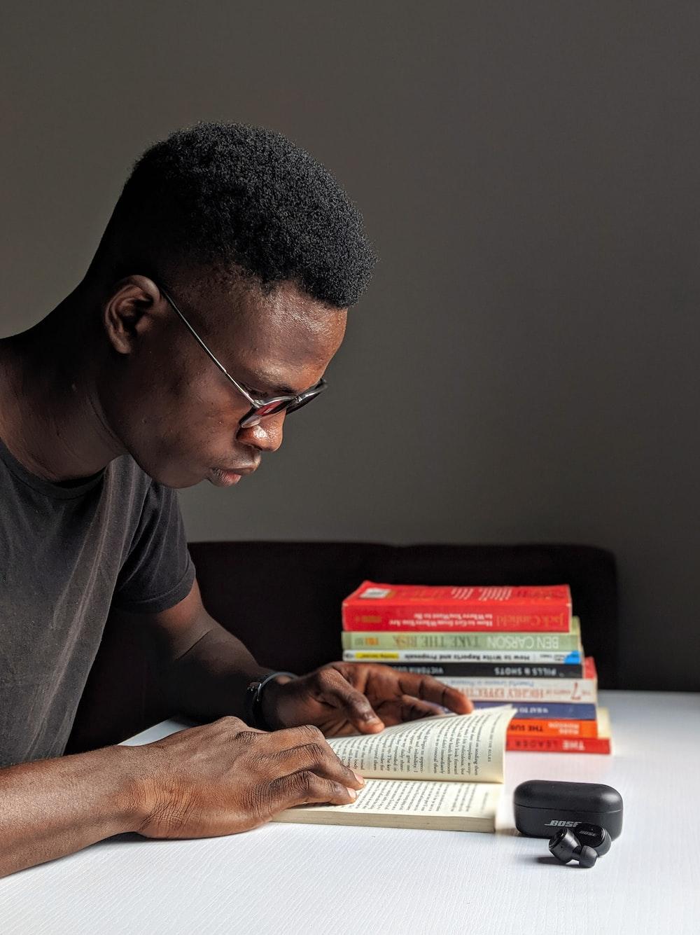 man reading inside room