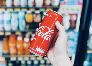 person holds Coca-Cola can