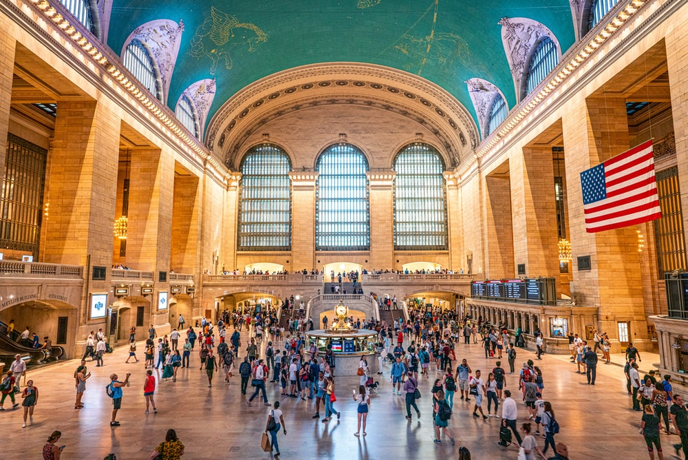 crowd of people walking in Grand Central Terminal