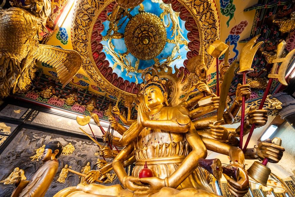 low-angle photo of Durga statue