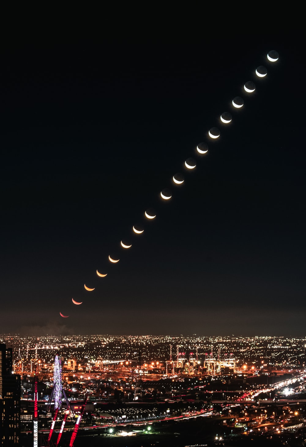 timelapse photo of moon at night