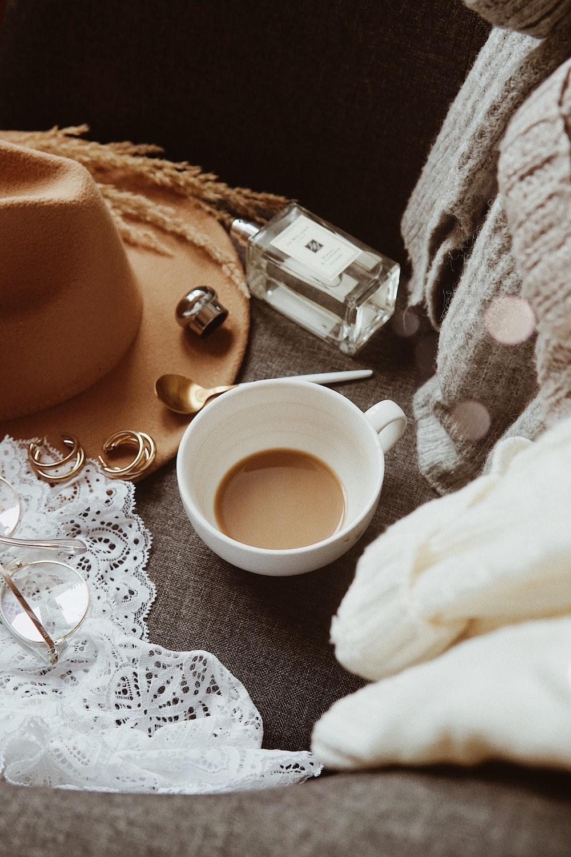 brown liquid on white ceramic teacup