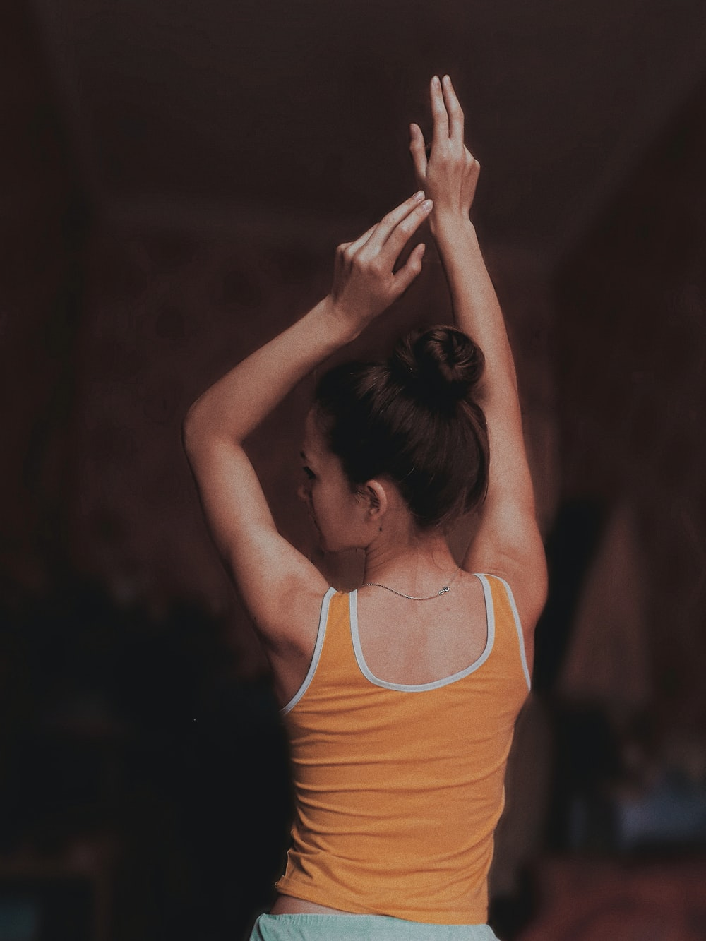 woman raising both hands