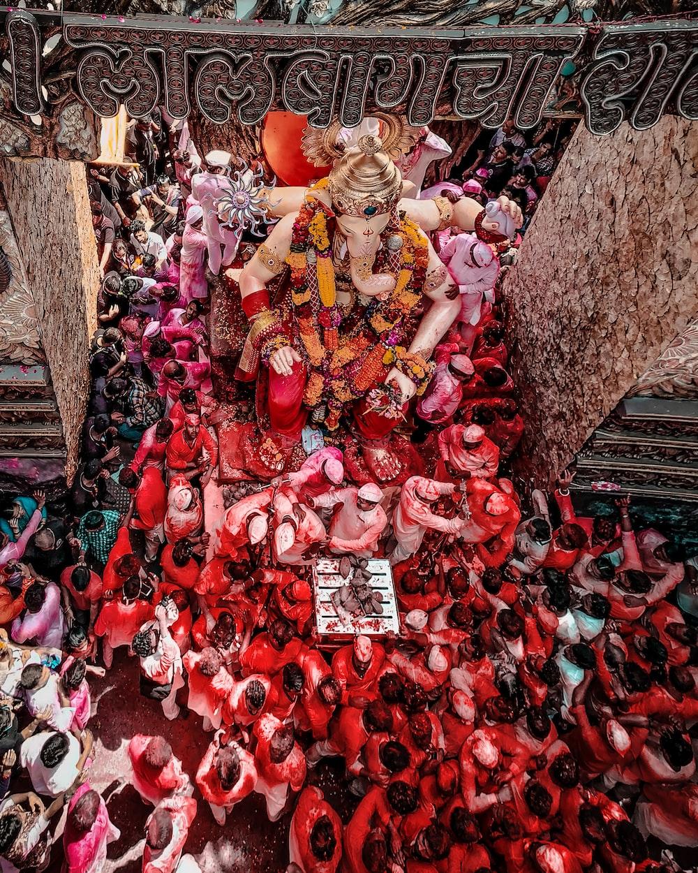 people gathering near Ganesha staue