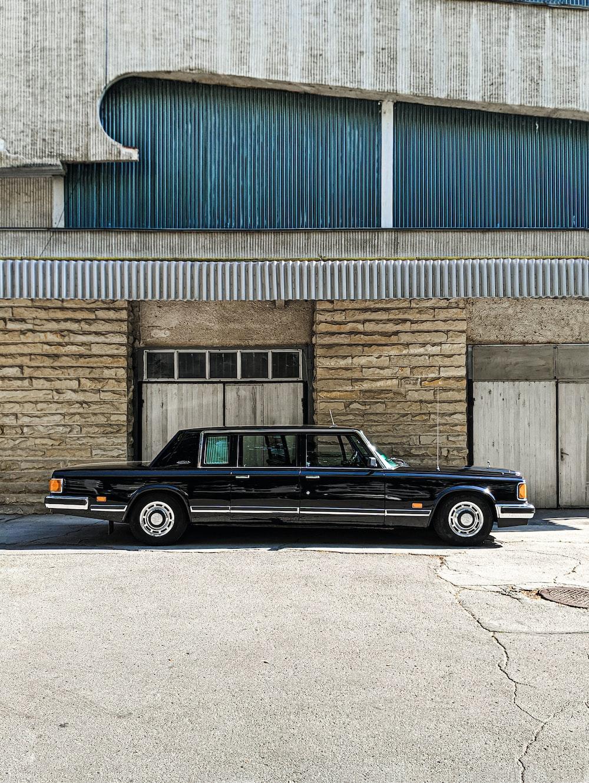 black limousine parked outside building