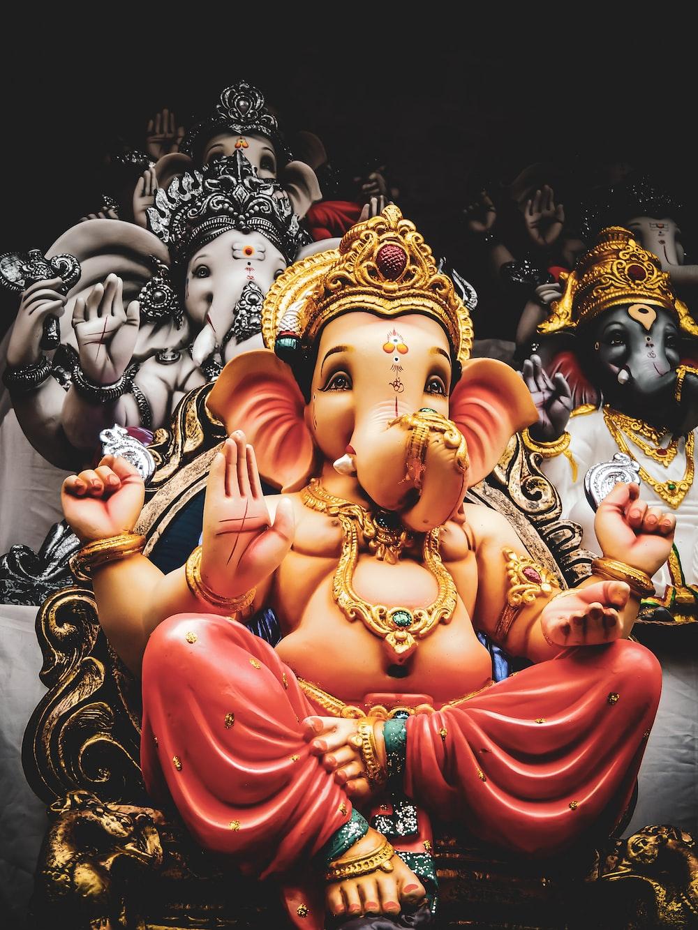 three Lord Ganesha statuettes