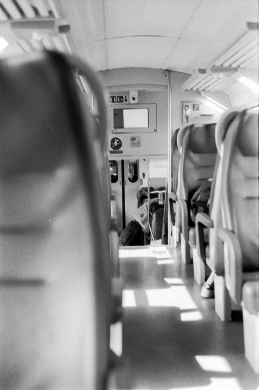 grayscale photography of plane passenger seat