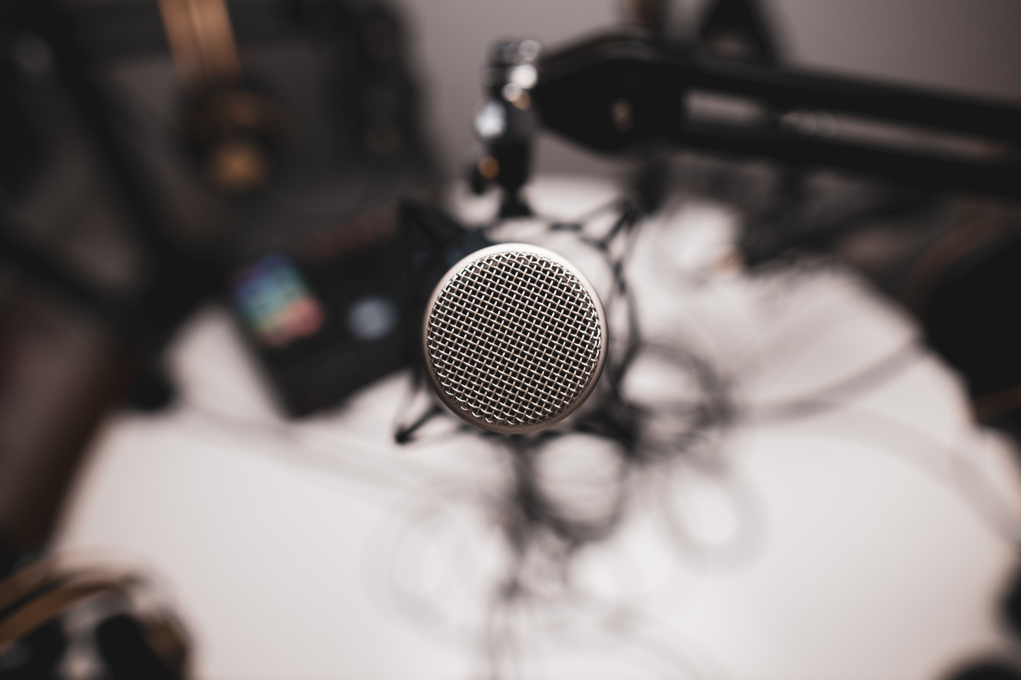 A direct shot of a professional microphone used for podcasting