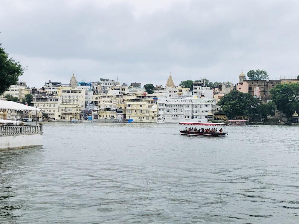 passenger boat near houses