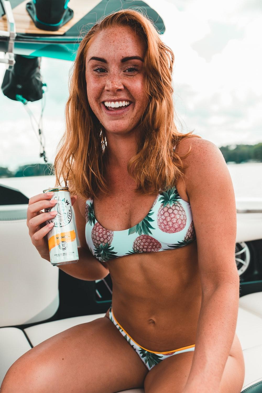 smiling woman wearing pineapple print bikini