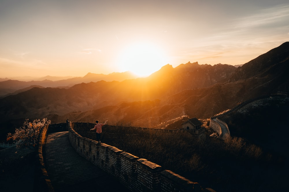 person walking on walls of Great Wall of China