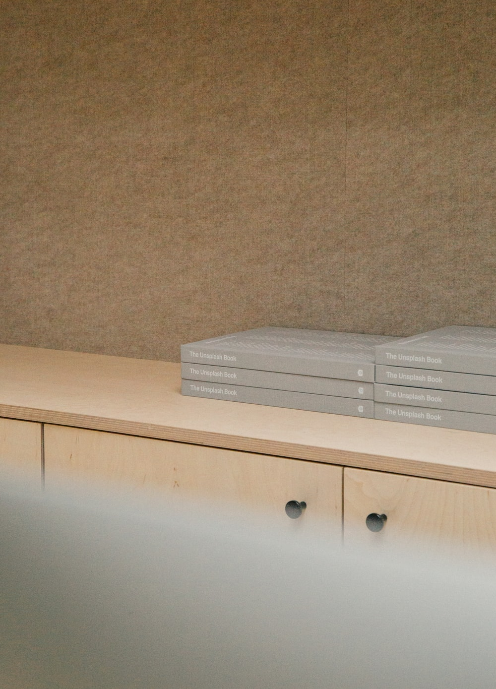 gray boxes on wooden console cabinet