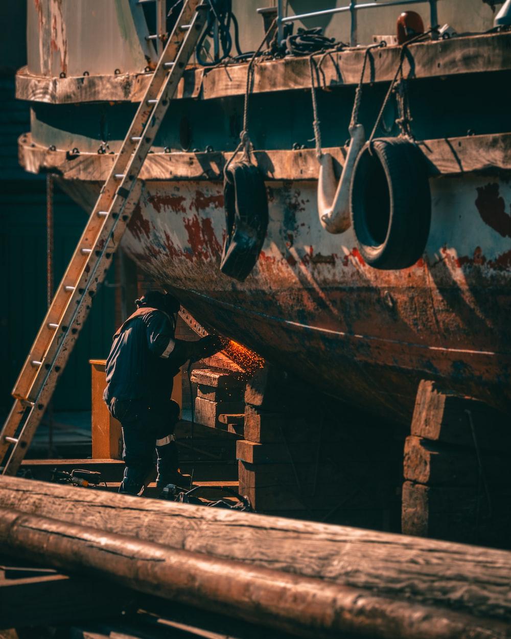 man standing beside boat