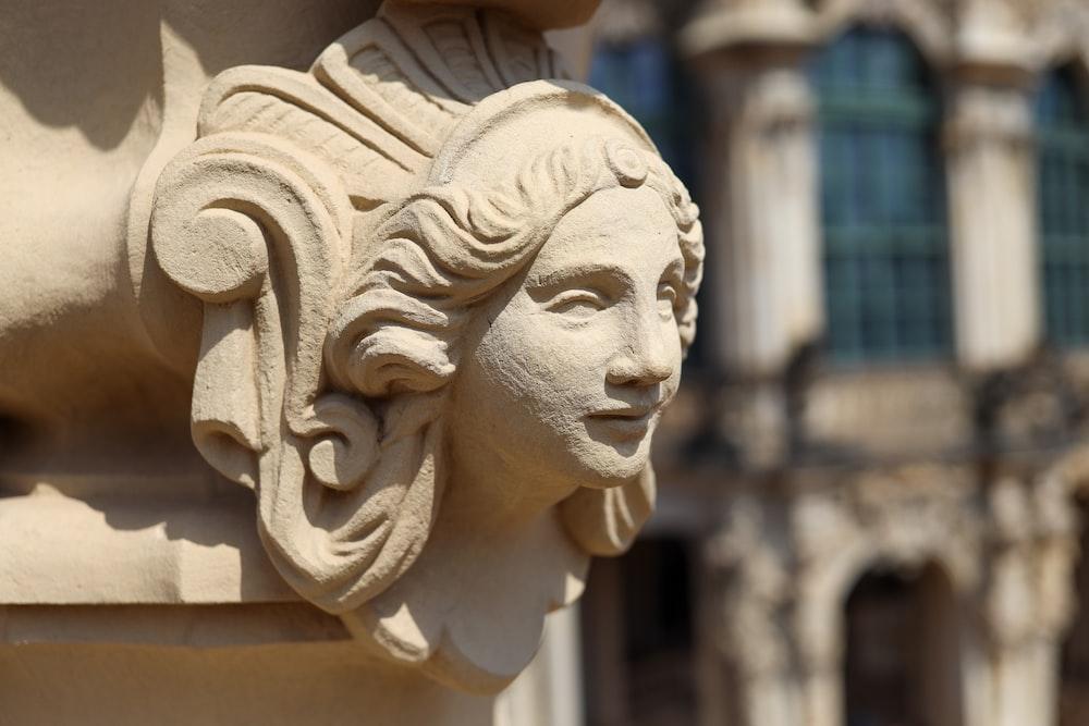 concrete statue of woman's face
