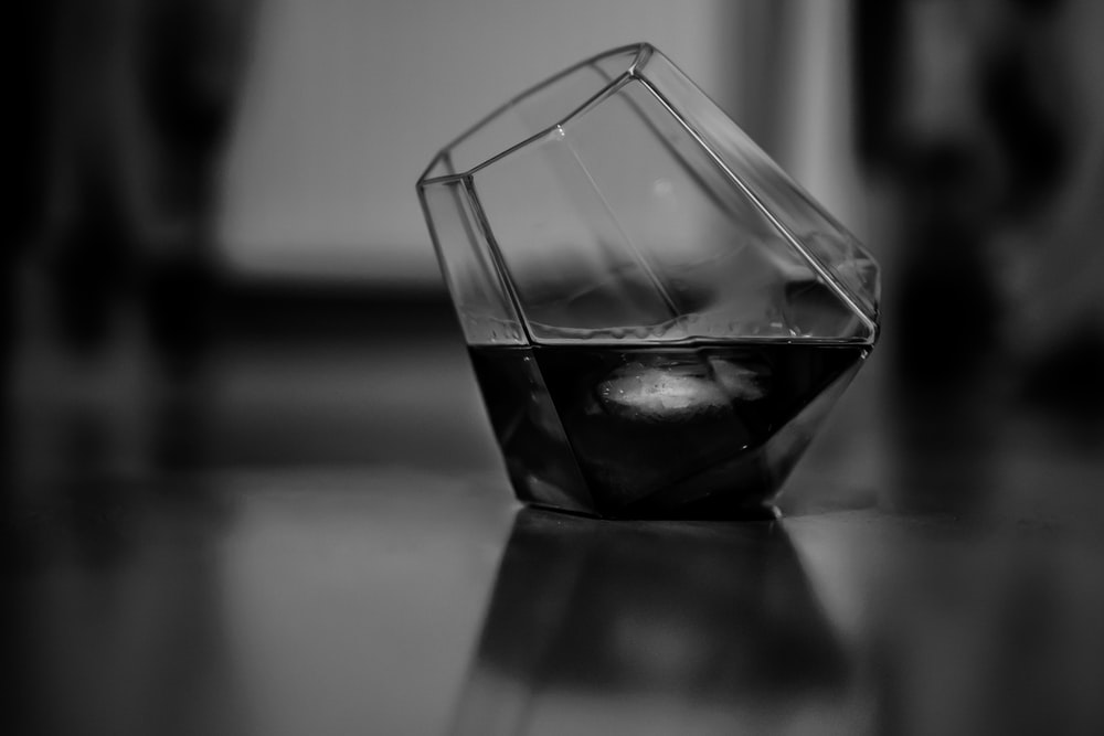 grayscale photo of drinking glass