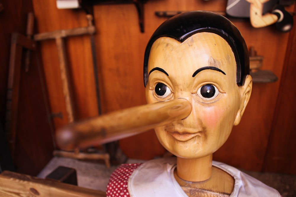 selective focus photography of Pinocchio puppet
