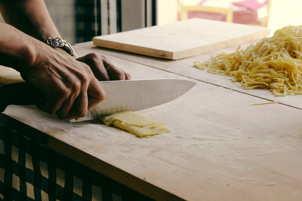person chopping dough