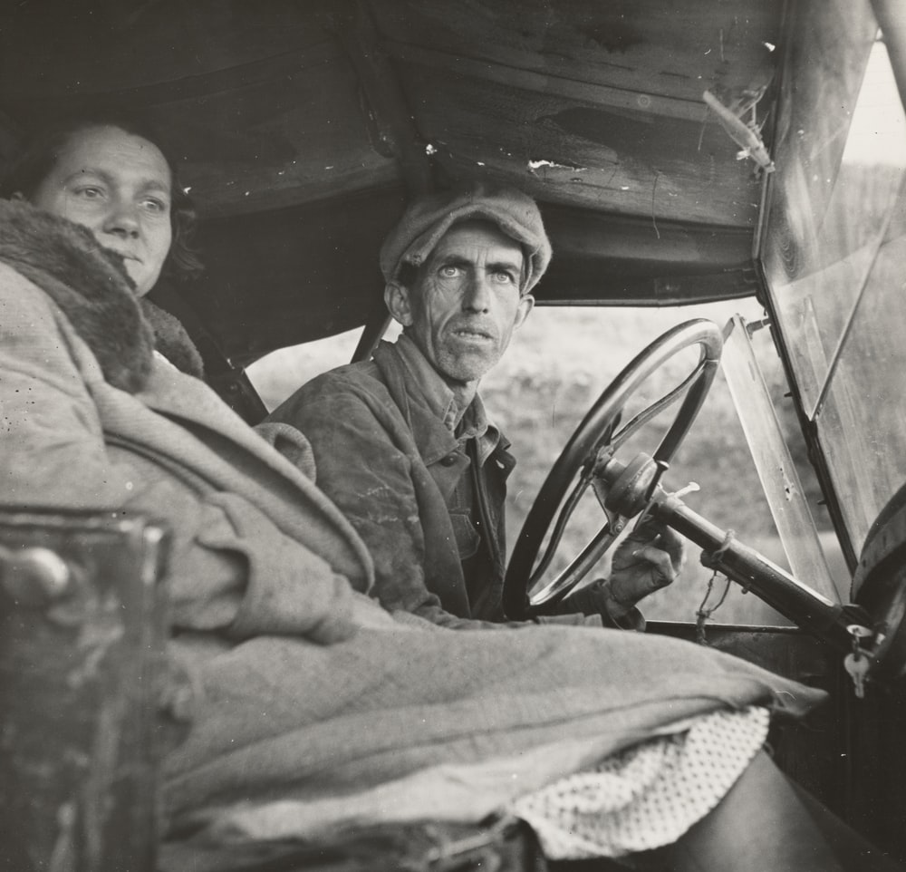 two man and woman sitting inside car during day