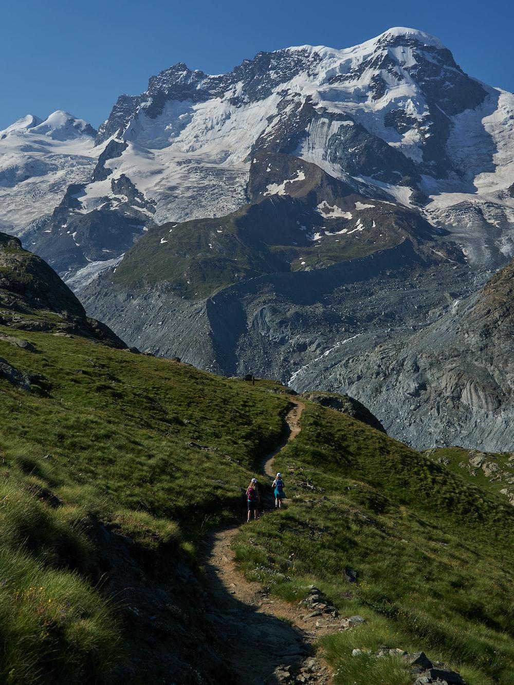 people walking on mountain