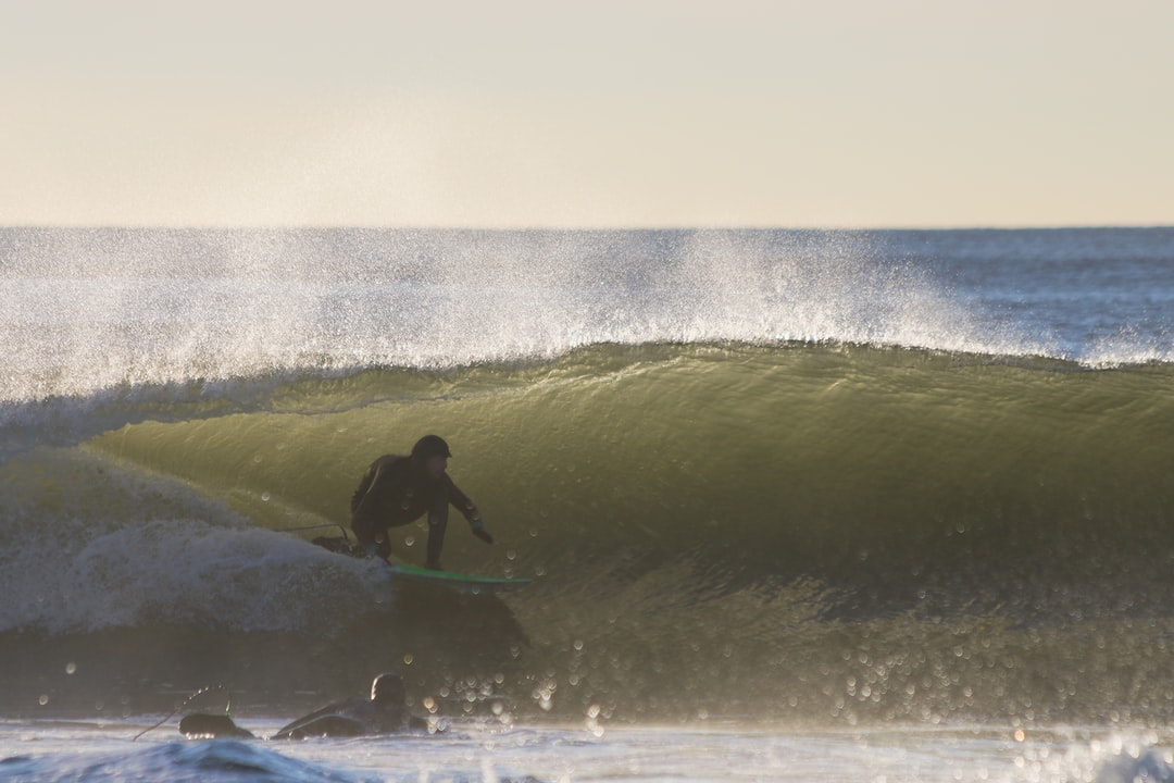A surfer lining up for the barrel somewhere in Long Island, NY. Winter surfing can be freezing, but the rewards are always worth the effort. Follow on Instagram @wildlife_by_yuri