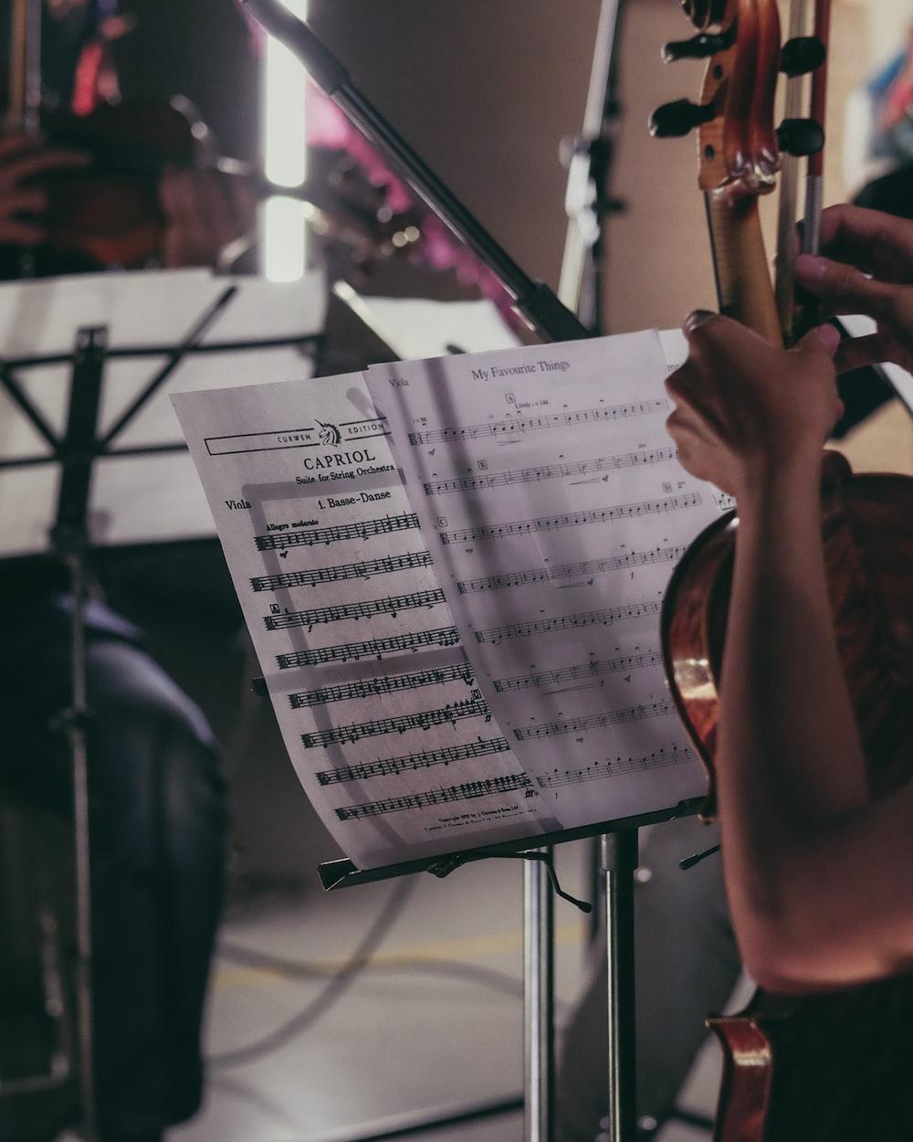 person holding violin