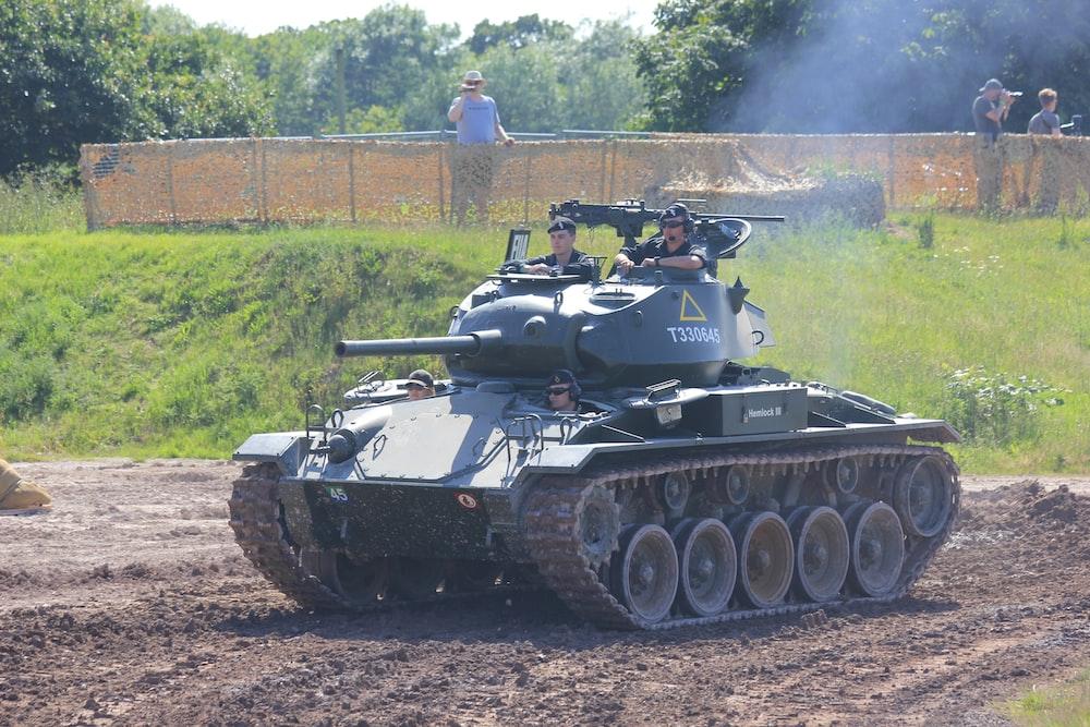 men in battle tank