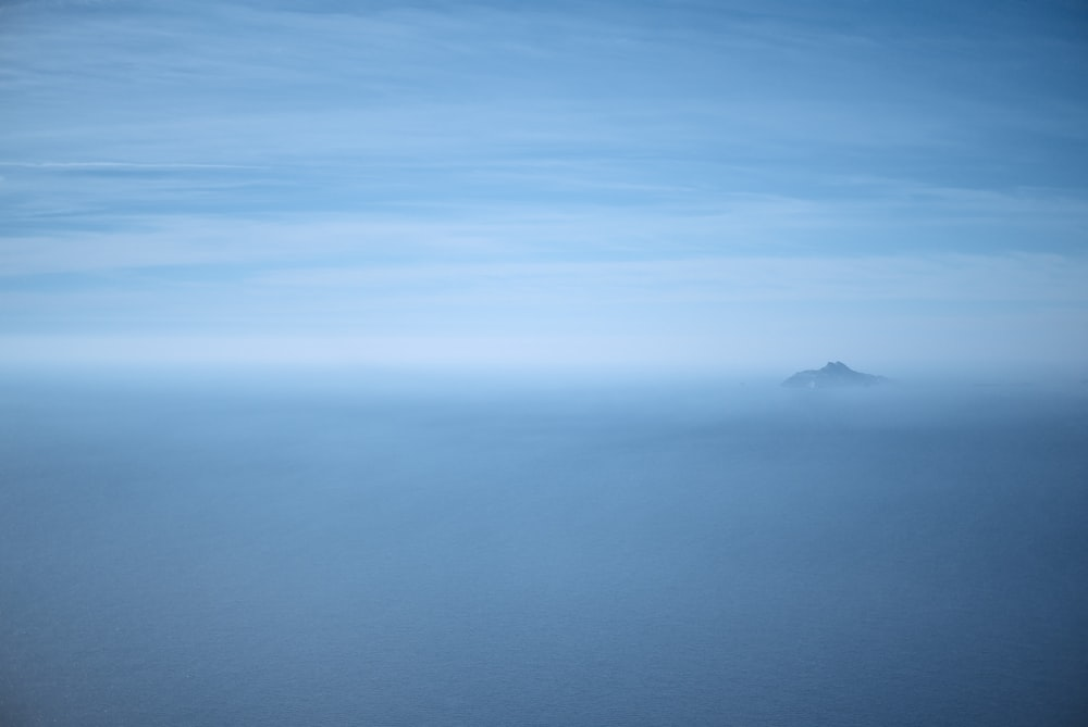 silhouette of mountain and sea of clouds