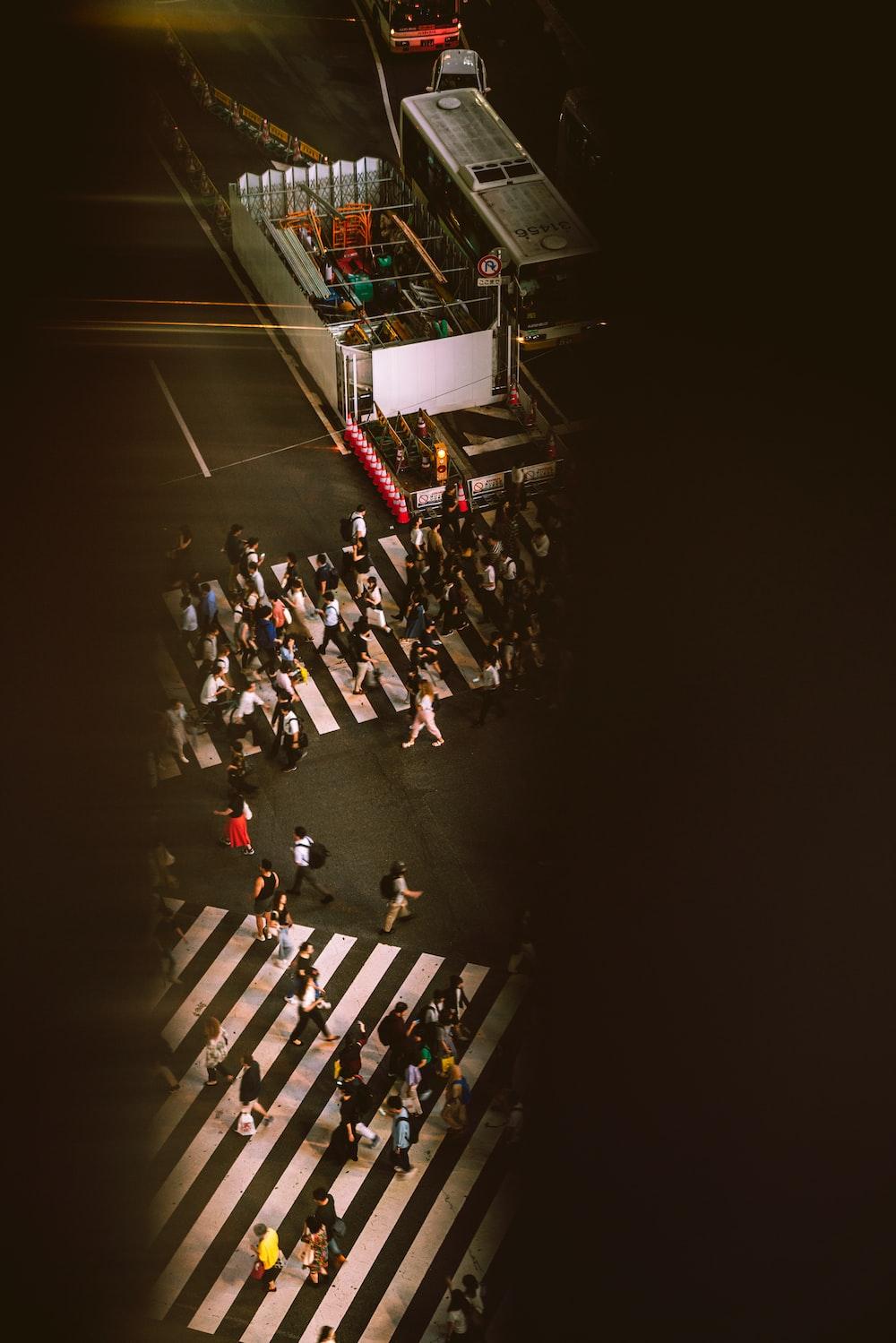 people crossing the crossroads