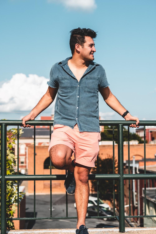 man leaning on railings