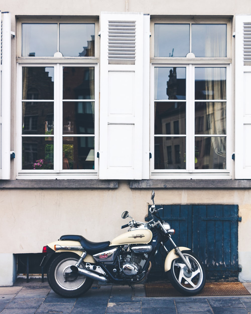 motorcycle parked outside house