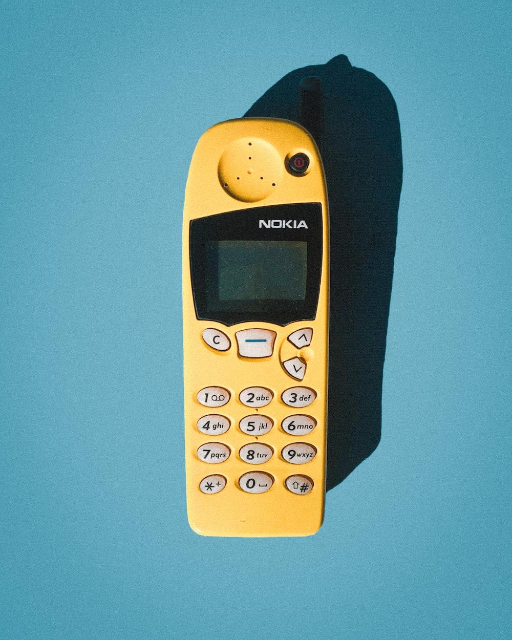 yellow and black 5110 telephone