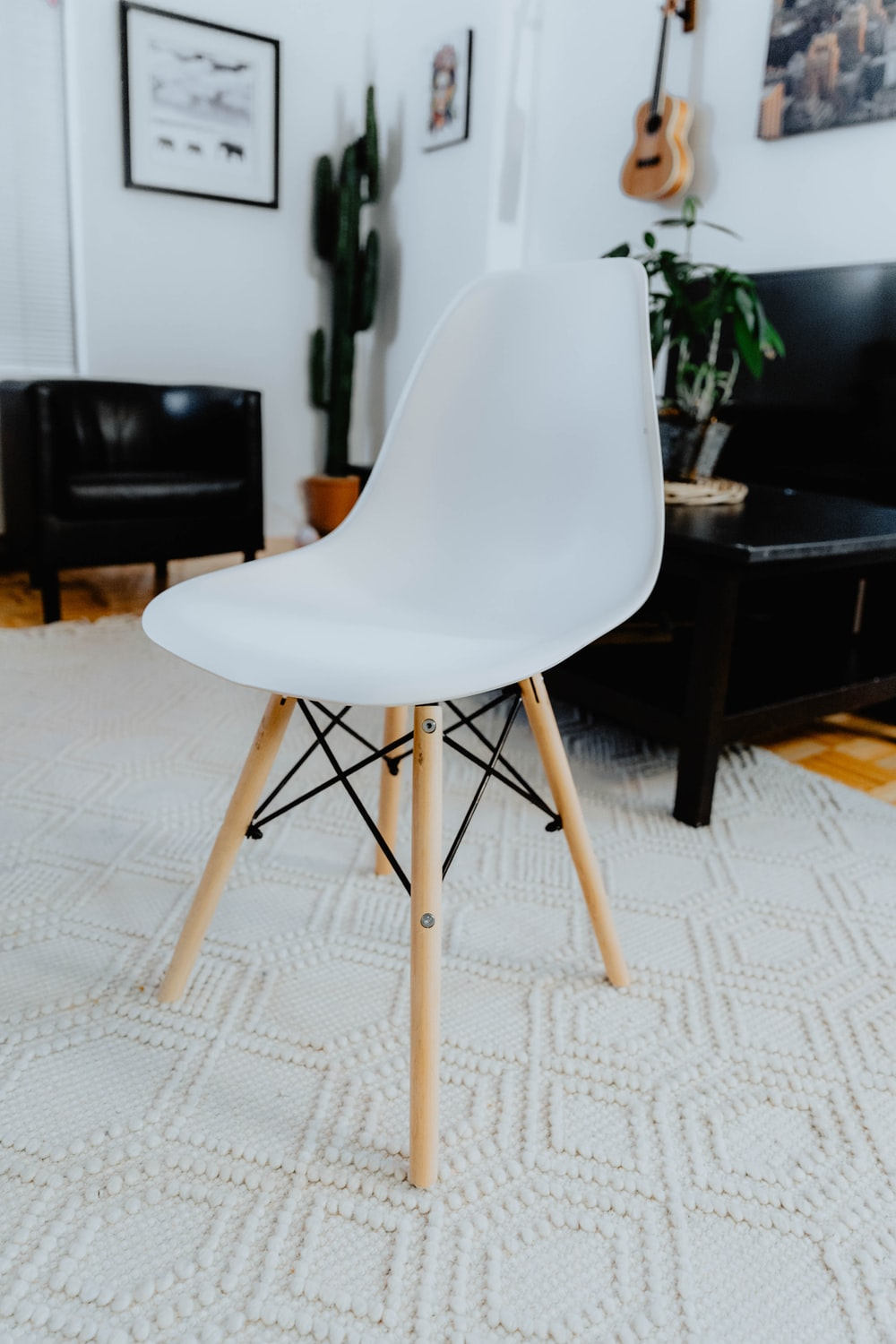 white and beige chair near coffee table