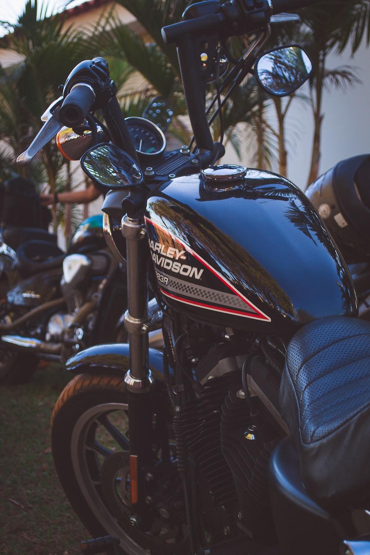 black Harley Davidson cruiser motorcycle