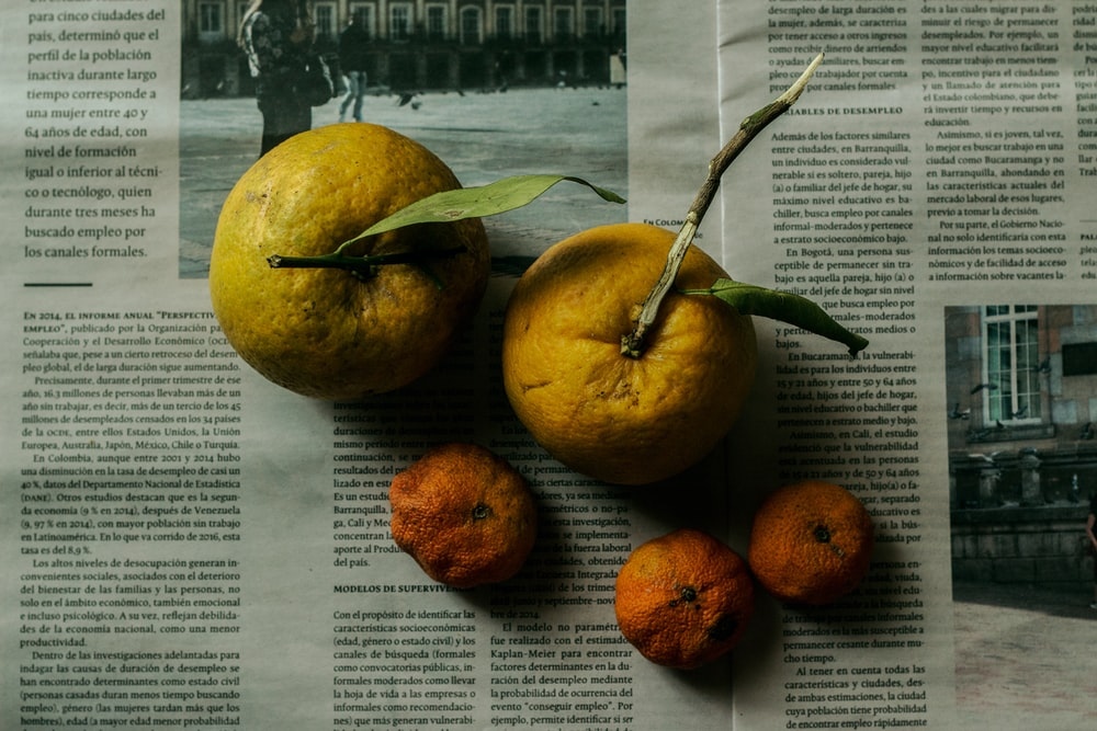 two yellow orange fruits