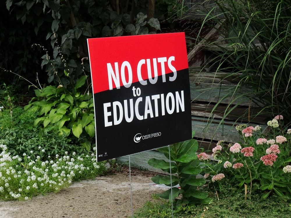 No cuts to Education signage
