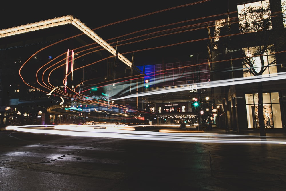 city street during nighttime time lapse photography