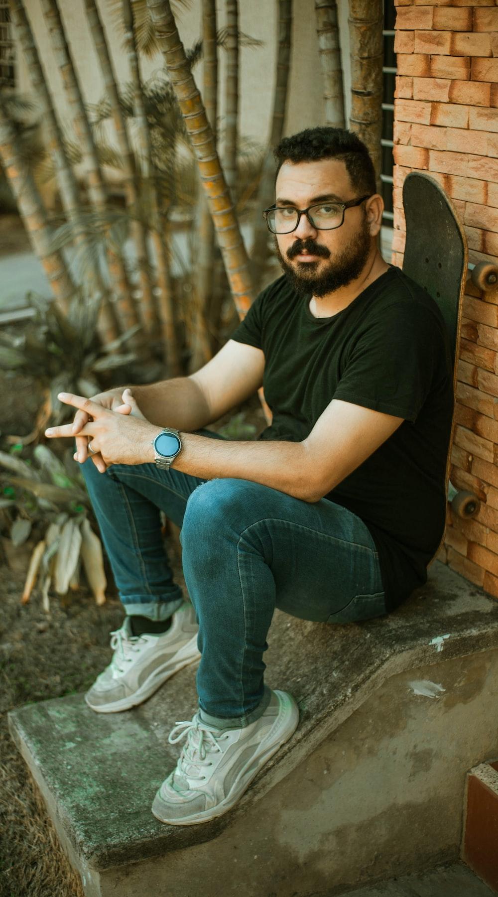 man sits near wall