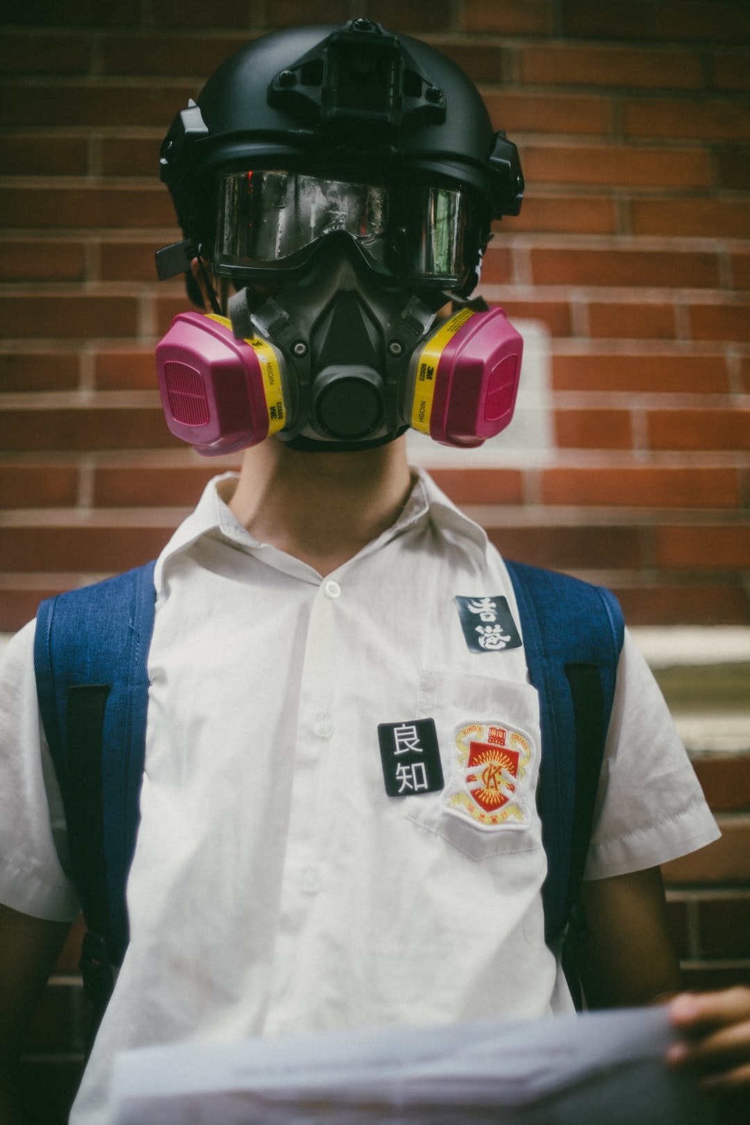After a summer of demonstrating in the streets, high school students in Hong Kong starting the new school year on Monday arrived to class wearing gas masks and joined hands to form human chains. Stickers on the shirt read 'Hong Kong' and 'conscience' demanding a call for universal suffrage in Hong Kong and an independent inquiry into accusations of police brutality - September 2019