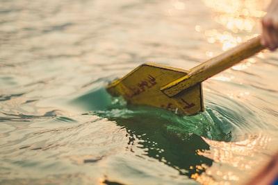 yellow boat paddle