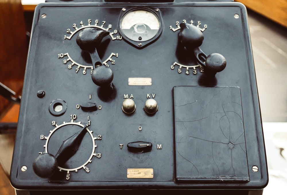 black electronic device with knobs